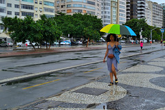 Between the rain and the sun. (markvanmarx) Tags: faces people urban southamericastreets streetphotography lifestyle discovercity belovedstories freedom nationalgeographic documentaryphotography magnumphotos photojournalism nikonambassador nikonexperience 35mm southamerica compositionkillerz travel cityscape riodejaneiro rio discover brasil brazil brasilpatriaamada adventure walk southamericapeople brazilianpeople she brazilianfaces women brazilianstreets calcadinha calcadinhacopacabana copacabana urbanscape street minimalism