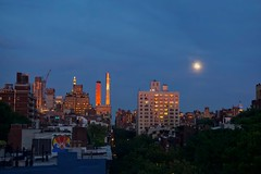 Between the moon & New York City (Andreas Komodromos) Tags: city color architecture clouds buildings hotel evening chelsea cityscape dusk highrise colourful andreaskomodromos newyorkcity light sunset shadow sky urban usa moon newyork reflection rooftop skyline night landscape photography view skyscrapers manhattan portfolio residential westchelsea nyandreas