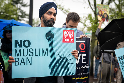 A demonstrator with a No Muslim Ban sign sign at the Supreme Court as the oral arguments on Trump's travel ban take place inside, Washington DC