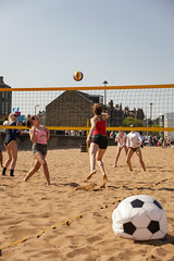 Portabello Beach April 2019-19 (Philip Gillespie) Tags: edinburgh portabello scotland summer sun sky sea beach sand people men women boys girls bikini bathing swimming water wet splash waves hands feet legs arms heads faces hot sport volley ball activities jumping leaping diving colour mono blue yellow orange pink outdoor outside nature firth forth boats sailing play playing art composition canon 5dsr tones light shade bright warm fun