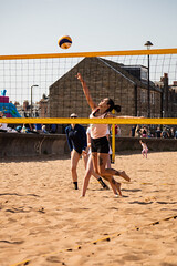 Portabello Beach April 2019-11 (Philip Gillespie) Tags: edinburgh portabello scotland summer sun sky sea beach sand people men women boys girls bikini bathing swimming water wet splash waves hands feet legs arms heads faces hot sport volley ball activities jumping leaping diving colour mono blue yellow orange pink outdoor outside nature firth forth boats sailing play playing art composition canon 5dsr tones light shade bright warm fun