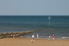 Portabello Beach April 2019-2 (Philip Gillespie) Tags: edinburgh portabello scotland summer sun sky sea beach sand people men women boys girls bikini bathing swimming water wet splash waves hands feet legs arms heads faces hot sport volley ball activities jumping leaping diving colour mono blue yellow orange pink outdoor outside nature firth forth boats sailing play playing art composition canon 5dsr tones light shade bright warm fun