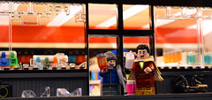 """Sorry about your window!"" (Andrew Cookston) Tags: lego dc comics shazam captain marvel captainmarvel freddyfreeman zacharylevi jackdylangrazer geoffjohns gas station corner convenient store snacks robbery broken glass editing photoshop custom minifig lab9 lab9minifigures lab9minifgs macro toy still life photography andrew cookston andrewcookston"