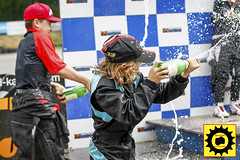 _5BK0883-4 (Sprocket Photography) Tags: warley warleygap brentwood essex brentwoodkarting allstarscup brentwoodkartingjuniorraceleague league championship race racing motorsports kart karting gokart wheel helmet youth sports podium champagne celebration spray soaking cap