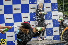 _5BK0884-5 (Sprocket Photography) Tags: warley warleygap brentwood essex brentwoodkarting allstarscup brentwoodkartingjuniorraceleague league championship race racing motorsports kart karting gokart wheel helmet youth sports celebration champagne podium soaking spray cap