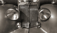 Balance & Beauty (Jon Scherff) Tags: sepia balance symmetry automobile car sportscar roadster triumphcar britishcar classiccar antiquecar elegant headlights grille dignified centered chrome wideangle