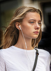 Portrait (D80_536099 - 1) (Itzick) Tags: denmark copenhagen candid color colorportrait blonde youngwoman earphones earrings face facialexpression streetphotography d800 itzick