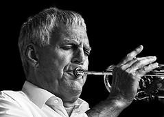 Portrait (D80_538884) (Itzick) Tags: denmark copenhagen candid bw face facialexpression trompetist trompet streetphotography blackbackground music d800 itzick