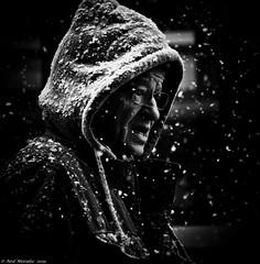White walker. (Neil. Moralee) Tags: austria2018neilmoralee neilmoralee man face portrait candid street snow snowing austria winter hat hoody hoodie dark black white bw blackandwhite blackwhite cold wet season neil moralee nikon d7200 snowfall falling old mature