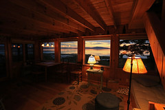 Outside from within (GLC 392) Tags: life park morning blue mountain me water lamp america sunrise out point outside island bay cabin mt looking desert side hill maine cadillac hills national edge inside harriman pure preserve brooklin narrows acadia 0453 wood light reflection stairs seat couch lover dawn