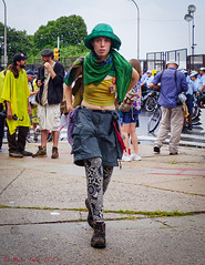 Green Rain Hat and Scarf (ViewFromTheStreet) Tags: allrightsreserved blick blickcalle blickcallevfts calle copyright2019 pennsylvania philadelphia photography stphotographia streetphotography viewfromthestreet amazing boots candid candideyecontact classic color crosswalk eyecontact fashion female girl green hat midriff pavement portrait sidewalk street streetportrait style topper unique vftsviewfromthestreet wild woman yellow ©blickcallevfts ©copyright2019blickcalle
