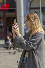 coat (Henk Overbeeke Atelier54) Tags: girl street candid longhair sunny blond phone photographing jeans