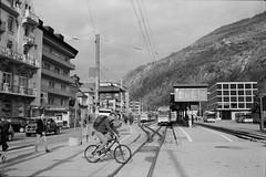 Brig Bahnhofplatz (vladixp) Tags: fp4 fp4plus fp480 d76 14min 20c 12 praktica mtl5 flektogon k2 pf7250u 3600dpi 35mm yellowfilter filmscan 35mmfilm film bw bwfilm filmphotography negative scanned svizzera schweiz switzerland suisse brig valais