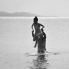 plunging (mare_maris) Tags: blackandwhite moments beach sea kid child father togetherness beachphotography childhood girl blackandwhiteshoots water splashes motion fun enjoyment play photography maremaris nikon greece plunge family inmersión dive splash dip mare bambino gioia gioco mar niño alegría juego mer enfantμjoie jeu meer kind freude spiel море ребенок радость игра 大海, 孩子, 喜悦, 比赛中, 海、 子供、 喜び ゲーム、 summer leisure