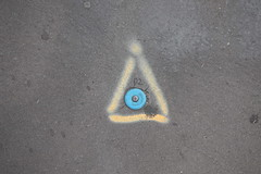 17th July 2019 (themostinept) Tags: lettering letter number triangle p2 blue yellow grey ground pavement circle surveymark london kingscross n1 islington