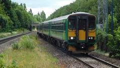 Two generations at Acocks Green (The Walsall Spotter) Tags: acocksgreen railway station warwickshire class153 sprinter dmu dogbox 153375 153356 diesel multipleunit class170 turbostar 170509 emptycoachingstock britishrailways networkrail