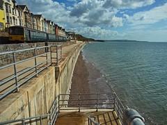 Dawlish Seawall (janedoe.notts) Tags: england unitedkingdom devon dawlish train transport sea beach water bluesky blue seafront seawall clouds railway