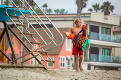 Oceanside Lifeguards (EthnoScape) Tags: oceanside california cityofoceanside firedepartment firedept lifeguard lifeguards oceansidelifeguard oceansidelifeguards training trainer team teambuilding community culture anthropology anthropologist drown drowning surf lifesaver lifesavers birdwell birdwellbeachbritches salvavida salvavidas rescue rescuer rookie swim swimming swimmer swimmers athlete athletic brave bravery hero heroic health fitness boardshorts bikini wetsuit neoprene lycra fiberglass polyurethane danger riptide ripcurrent yellow sun sunset baywatch rubber fins swimfins tower lifeguardtower station lifeguardstation beach shore ocean water safety jetski summer ethnoscape ethnoscapeimagery outdoor seaside