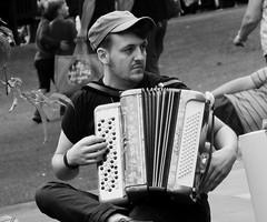 Carnival 2019 84 (byronv2) Tags: peoplewatching candid street performer newtown princesstreet princesstreetgardens carnival edinburghjazzbluesfestival edinburghjazzbluesfestival2019 festival parade blackandwhite blackwhite bw monochrome man portrait music musician accordion