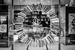 "The Lady in the Book Shop (""The Wanderer's Eye Photography"") Tags: 2019 bw bangalore britishmusuem canoneos450d canoneosdslr canoneosrebelxsi digitalphotography india photography rubenalexander streetphotography susanalexander thewandererseyephotography art backlighting backlit blackwhite booklover bookhouse books fineart fineartstreetphotography library monochrome people reader rimlighting rimlit single londonflickrphotowalk2019"