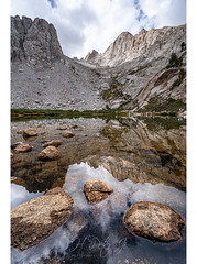 Scanned the lake for one last time (ScorpioOnSUP) Tags: a7iii bealpha easternsierra inyonationalforest jmt jmt2018 johnmuirtrail marylake sierranevada sonyalpha adventure backcountry clouds geology lake landscape landscapephotography mountains nature outdoors reflection rockformation thruhike wilderness
