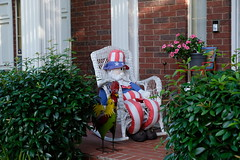 Uncle Sam (Gene Ellison) Tags: house porch brick rockingchair unclesam doll shrubs fijifilm provia sooc