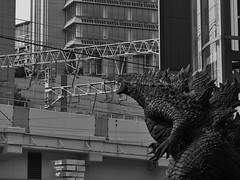 Godzilla attacks Osaka (peaceblaster9) Tags: godzilla osaka city figure building ゴジラ 大阪 町 ビル blackandwhite bnw bw blackwhite monochrome モノクローム モノクロ 白黒 ストリート street