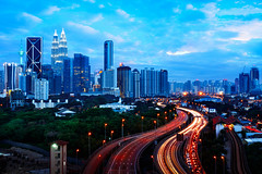Kuala Lumpur (Patrick Foto ;)) Tags: architecture asia blue building business busy city cityscape commercial corporate destination development downtown famous finance financial highway journey kl klcc kuala landmark landscape light lumpur malaysia metropolis metropolitan night office petronas place scape scene scenery sky skyline skyscraper sunset tall tourism tower towers town traffic trail travel twilight twin urban view kualalumpur