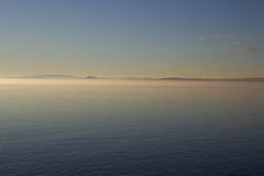 Dawn's golden hour (soniamarmen) Tags: water stlawrence river quebec canada sunrise horizon golden light blue sky still calm dreamy reverie morning