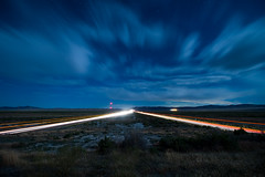 Thousand Mile Stare sRGB 15x10 (theskyhawker) Tags: night moody sky landscape moonlit interstate road headlights long exposure stars idyllic desert scene