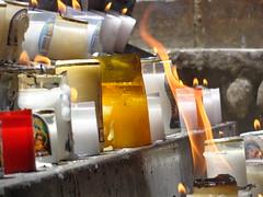 Prayers (Lorena Velásquez R.) Tags: colombia religion fire candles