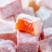 Close-up of candied fruit in powdered sugar