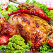 Fresh baked chicken with broccoli, lettuce, tomatoes and chili