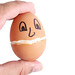 Hard Boiled Egg with eyes and smile in the hand