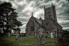 St Peter's Church in Brampford Speke (Christian Hacker) Tags: brampfordspeke stpeterschurch 15thcentury historicbuilding cemetary dark moody overcast granite stone old ancient landscape canon eos50d tamron 1750mm uk middevon tree tower steeple architecture