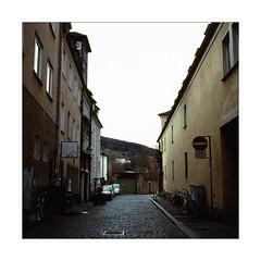 Into Emptiness (Thomas Listl) Tags: thomaslistl color analog filmphotography film square 6x6 mediumformat mediumformatfilm yashica yashicamat124g fuji velvia fujivelvia velvia100 urban contrast sky light mood 120 mundane emptiness würzburg
