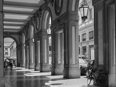 a Livorno (frastebio) Tags: città monocromo bicicletta persone portici lampione finestra
