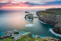 Never Stop Exploring (Francesco Gola) Tags: seascape waterscape landscape europe uk cornwall land end cliff lighthouse rocks clouds sunset warm green polarizer filter nisi zeiss arch sea water long exposure