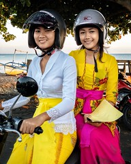 Ready for work! (Banjar village girls) (cresting_wave) Tags: iphoneography mobileography iphonephotography mobilephotography streetphotography iphonexsmax procamera snapseed lightroommobile people women helmet smile girls motorbike scooter costume traditional
