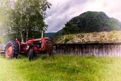 Tractor in Kvilldal (Oddbjørn Strand) Tags: kvilldal norway rural boathouses oldbuildings landscape
