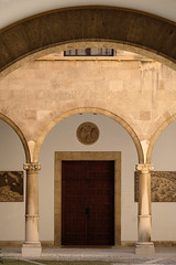 Courtyard arches and door (John Wilder Photography) Tags: architecture fuji arches fujixe3