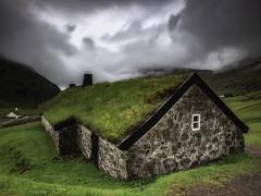 Faroe: Saksun (Maximilian Busl) Tags: saksun färöerinseln travel europe faroe gras sky clouds buildings water bay church green phaseone dramatic