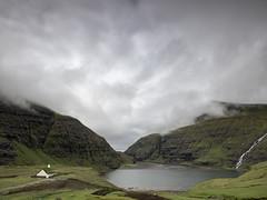 Faroe: Saksun (Maximilian Busl) Tags: travel sky green church water clouds buildings bay europe dramatic gras faroe saksun phaseone färöerinseln