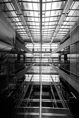 Everything Has a Beginning and an End (Thomas Hawk) Tags: america julia juliapeterson saltlakecity saltlakecitylibrary usa unitedstatesofamerica unitedstates utah architecture bw library mrsth reflection spouse wife