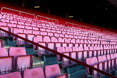 Vacant red chairs of stadium stand (jack-sooksan) Tags: vacant red chair stand stadium football soccer sport line row column unoccupied grandstand seat sitting empty furniture design outdoor slope building pattern decoration