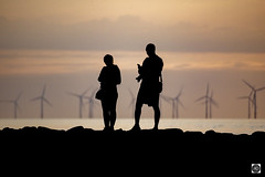 Waiting for Mary (alundisleyimages@gmail.com) Tags: silhouettes backlit people photographers windfarm cameras rocks beach tide water weather sunset nature waiting mobilephones socialmedia turbines shadows river merseyside port renewableenergy