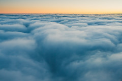 View of a sunrise above the clouds (A. Aleksandravičius) Tags: above airborne aircrafts airline airliner airplane atmosphere atmospheric aviation background bright cloud cloudy colorful cover flight fluffy fly holiday journey natural nature plane rise scenic set setting sky soft spectacular sun sunrise sunset top transport transportation travel trip vacation view window