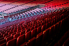 Vacant red chairs of stadium stand (jack-sooksan) Tags: vacant red chair stand stadium football soccer sport line row column unoccupied grandstand seat sitting empty furniture design outdoor slope wide panorama building pattern decoration