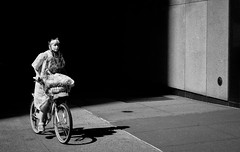 Cycling Noir (Kenneth Laurence Neal) Tags: newyorkcity urban cities bicycles bicyclist shadows contrast noir blackandwhite monochrome monotone blackdiamond nikon nikond7100 street streetphotography