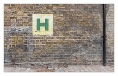 The Built Environment, East London, England. (Joseph O'Malley64) Tags: thebuiltenvironment newtopography newtopographics manmadeenvironment manmadestructure urbaninterest threemills threemillsisland eastlondon eastend london england uk britain british greatbritain wall brickwall londonbrick brickwork bricksmortar cement pointing patina waterdamage frostdamage airpollutiondamage acidraindamage hygroscopicsaltsinbrickwork drainpipe castirondrainpipe setts cobbles cobblestones cobbledroadsurface hydrant waterhydrant watersupply detritus victorian victorianbuilding victorianlondon stencilledsign h fujix fujix100t accuracyprecision